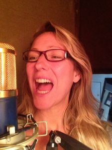 christine sings in the vocal booth, recording lead vocals
