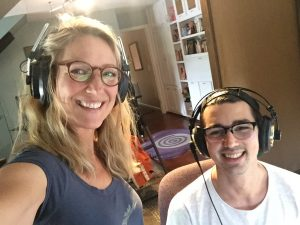 Christine Dente with producer, Julian Dente, both wearing headphones during vocal comping recording lead vocals.