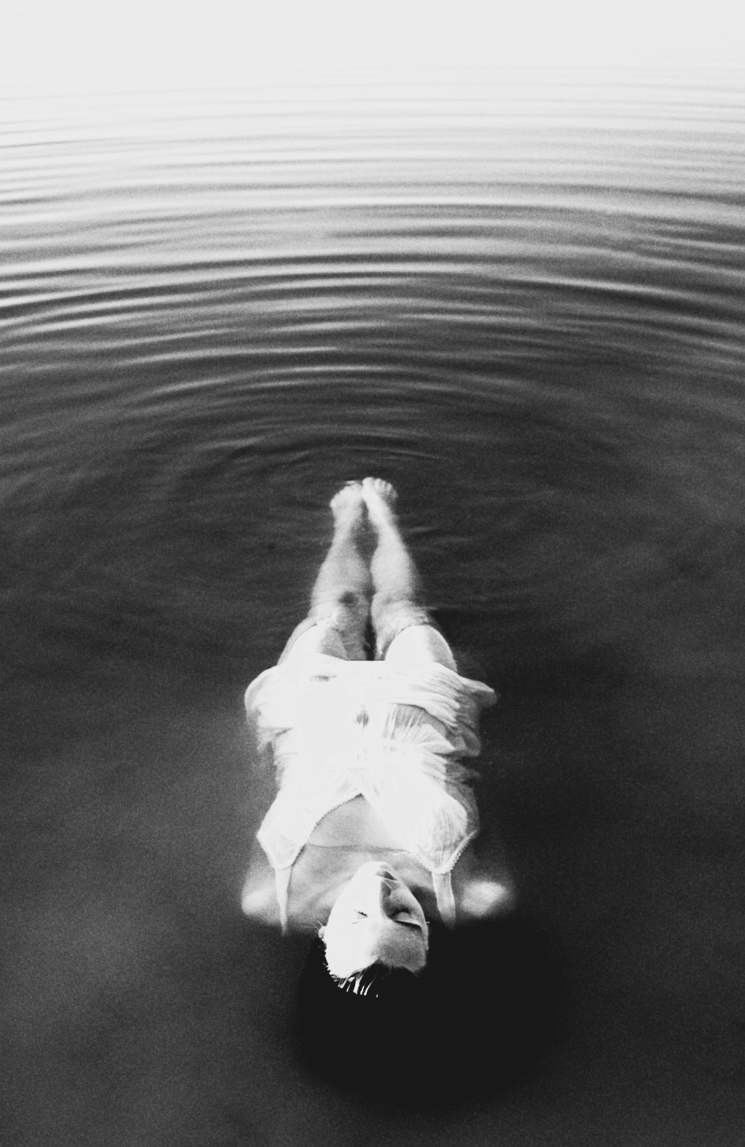 finding finding freedom: woman floating down a river