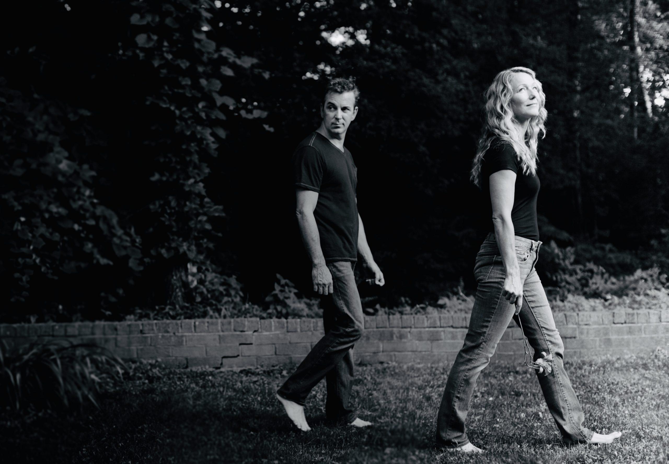 out of the grey aka christine and scott dente walk across a dark lawn toward a bright future
